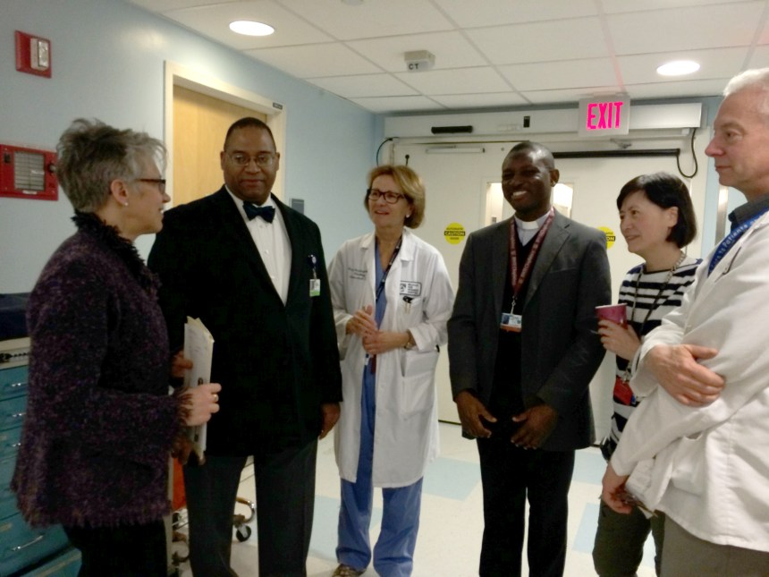 Members of the inter-professional Neurology ICU team during ethics rounds. From left to right: Martha Jurchak PhD, RN, Galen Henderson, MD, Mary Amatangelo, NP, Fr James Ojo, Ling Zhang, LICSW, Vince Vacca, MS, RN.