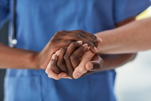 Closeup shot of a medical practitioner holding a patient's hand in comfort