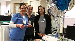 From left, Oncology nurses Meaghan Kiley, Chrissy Hale and Leslie Dunford share information about the certification process and benefits during Certified Nurses Day.