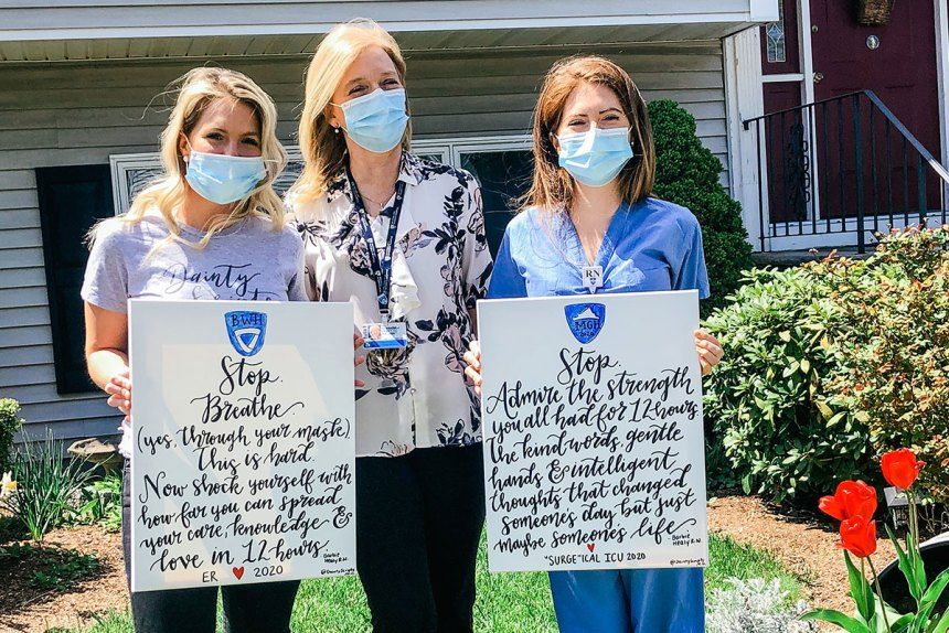 Maura, Barbara and Barbie Healy holding signs
