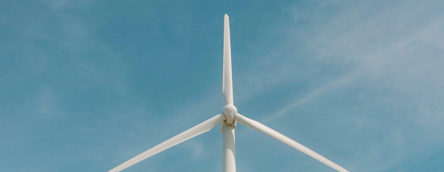 Image of single windfarm against blue sky