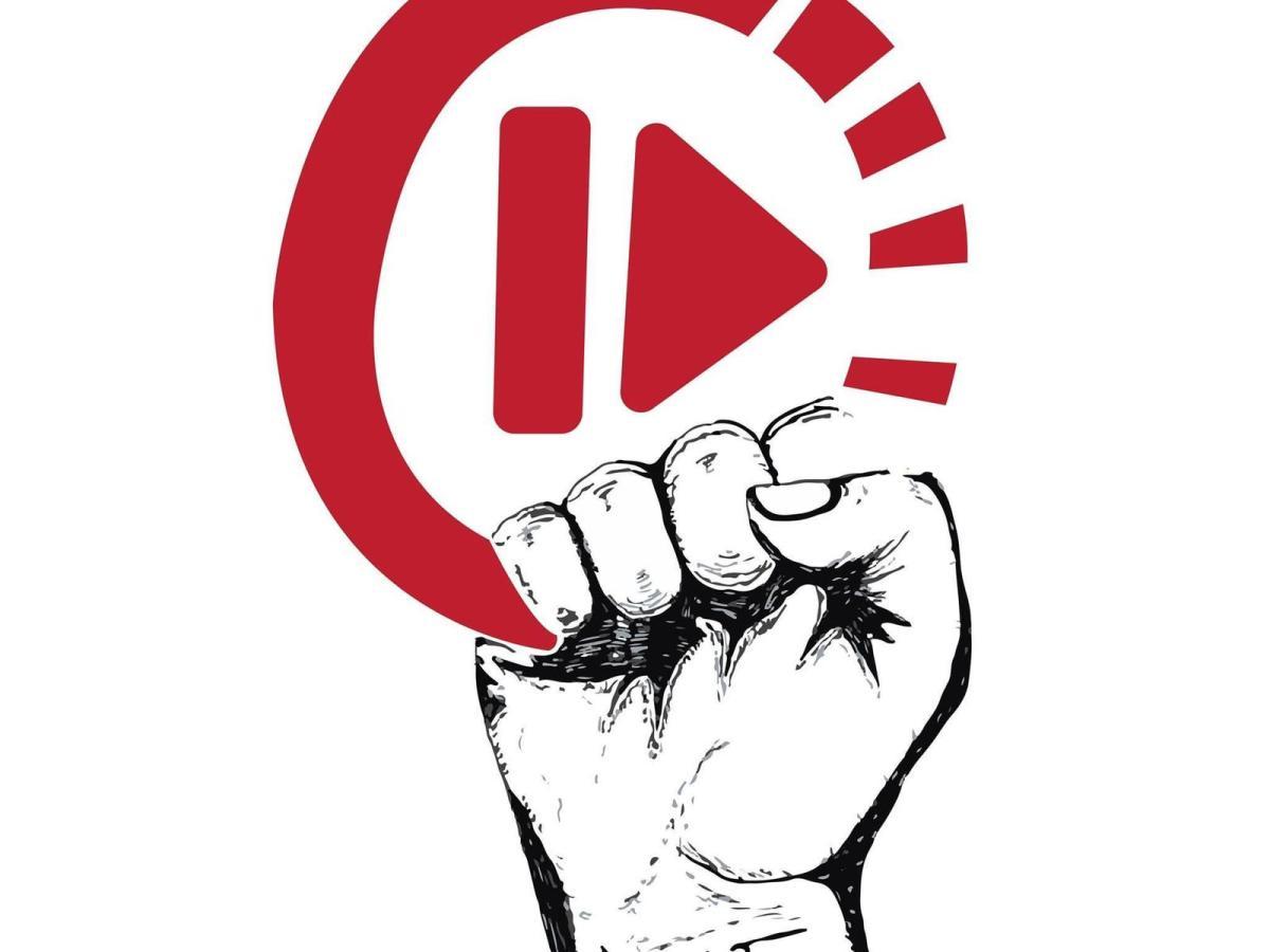 Logo - fist holding circle with arrow head inside