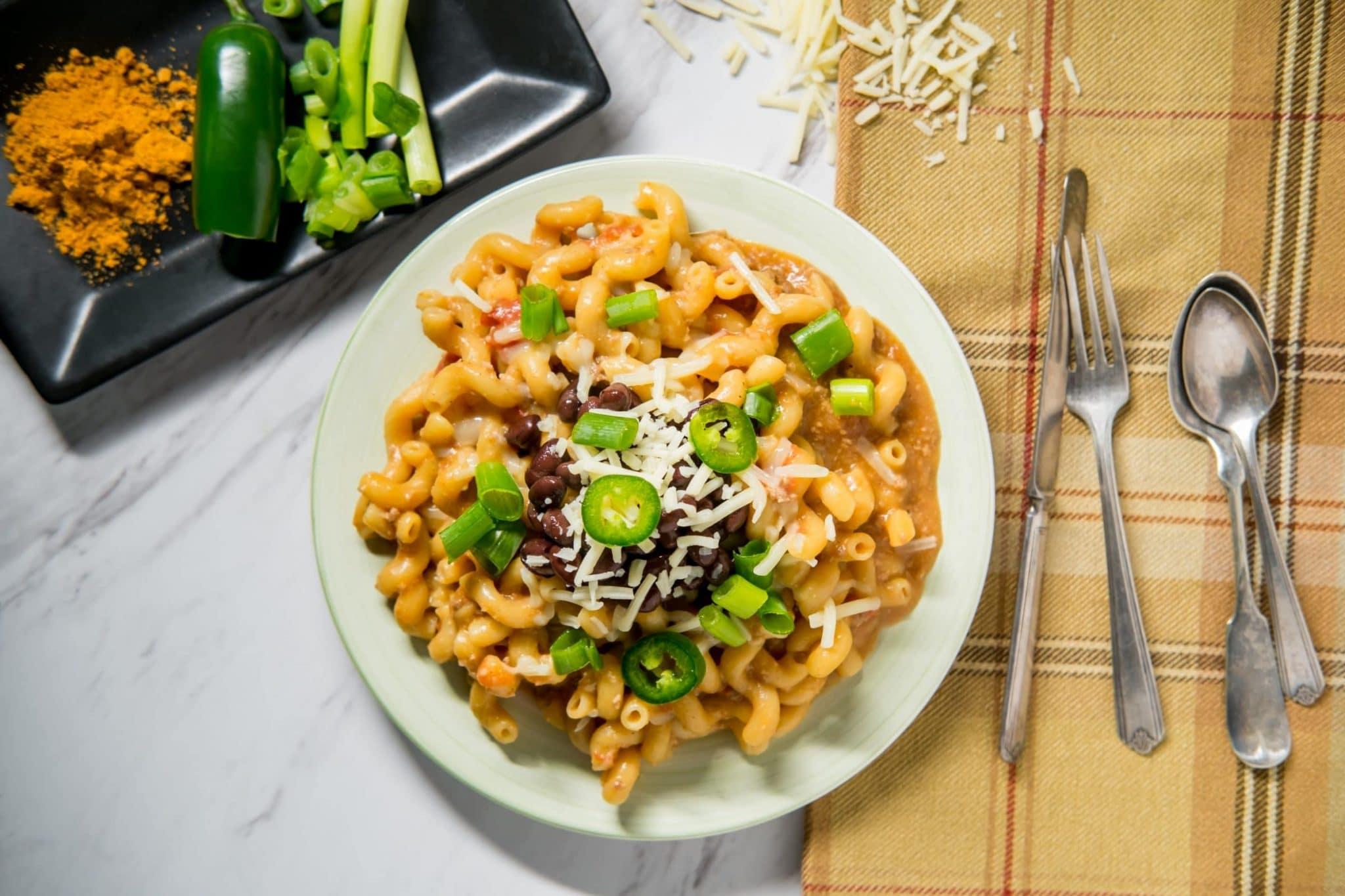 Shake up your next taco Tuesday with this Taco Pasta Recipe. Get the traditional flavor of tacos, but in an al dente pasta! #taco #pasta #tacotuesday #cheesy