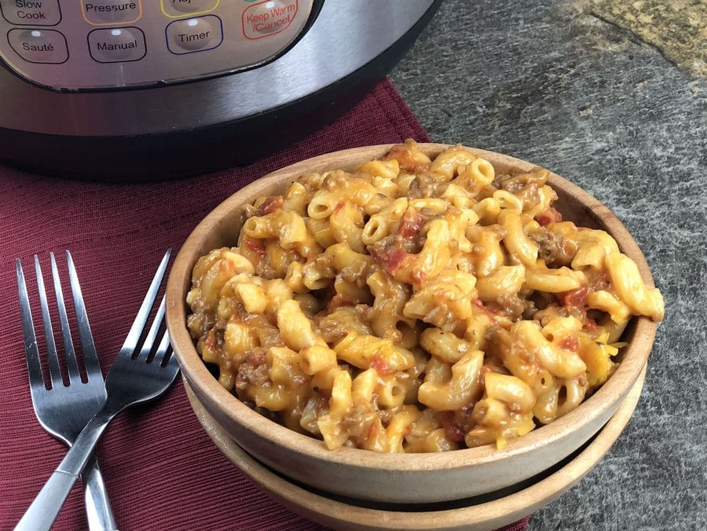 Instant Pot Cheesy Ground Beef Goulash. Now, you might be thinking this is like a goulash recipe your grandma used to make if so, you are wrong.   #groundbeef #instantpot #goulash #pressurecooking #easyrecipe #recipe #cheesy #pasta #macandcheese