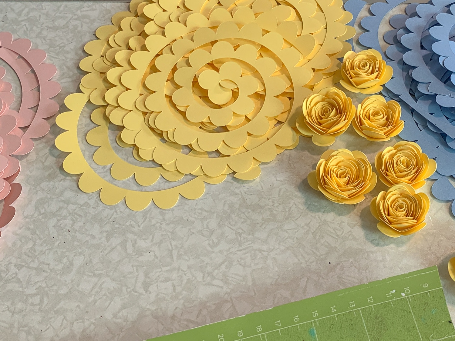 If you are wanting to learn how to make paper roses, then you are in the right place. With just a few supplies you can make beautiful paper roses. #paperflowers #cricut #cricutmade #freesvgfiles