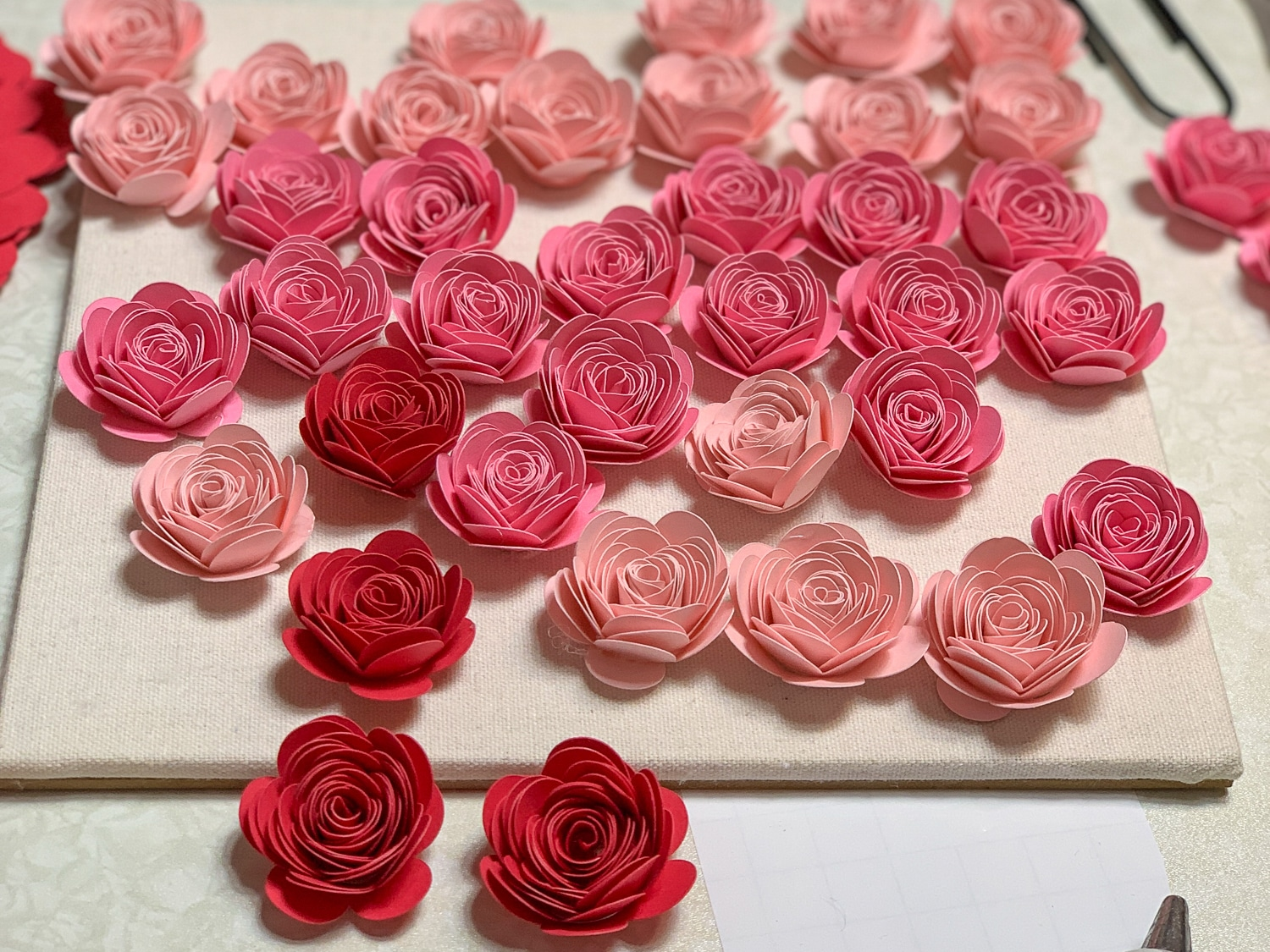 You learnedHow To Make Paper Rose now what to do with them. One of my favorite paper rose projects is the Ombre paper flower shadow box. #cricutmade