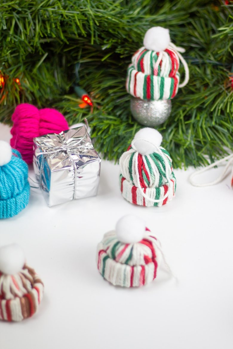 yarn hat diy christmas ornament make from red green and white yarn and toilet paper rolls