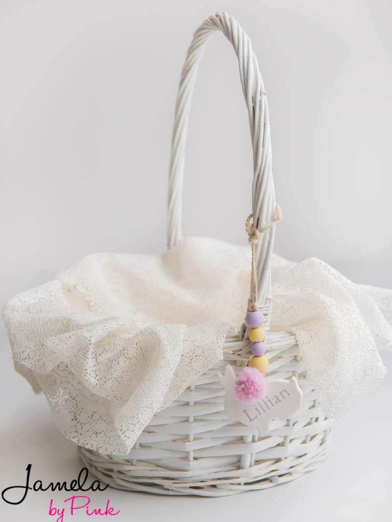 white wicker easter basket whole view with personalized easter basket tag