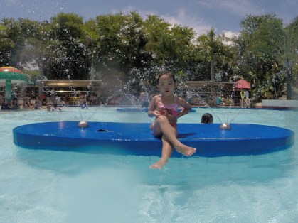 posing at the kiddie pool