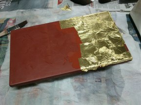 Gold applied in stages