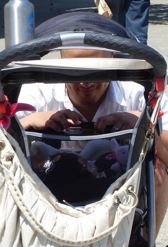 Father looking at baby in a stroller