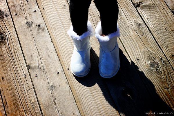 Sparkly booties on wooden floor