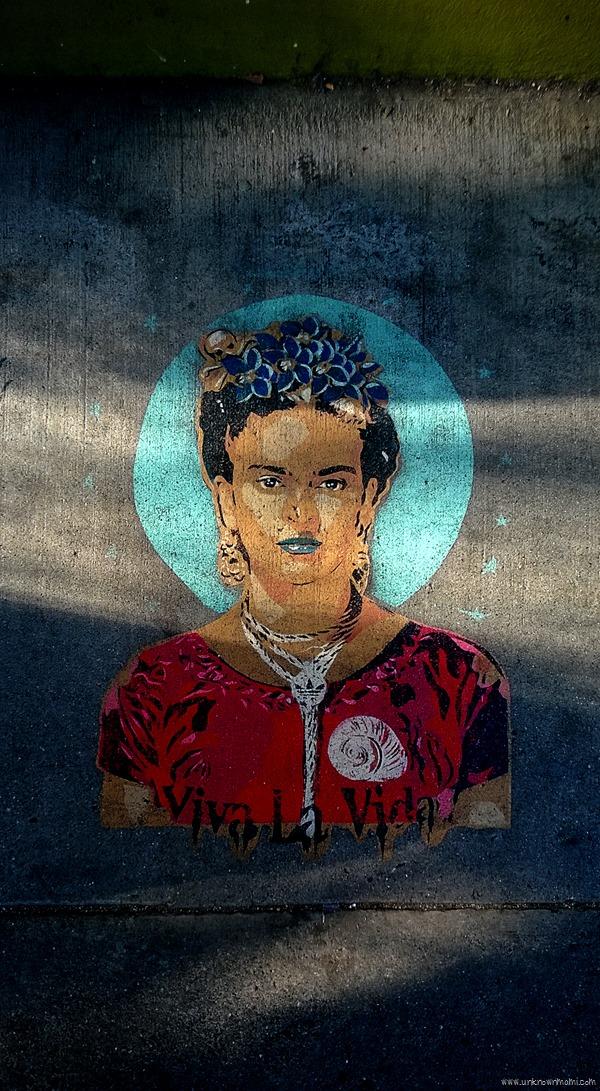 Frida Kahlo on the sidewalk of the Mission