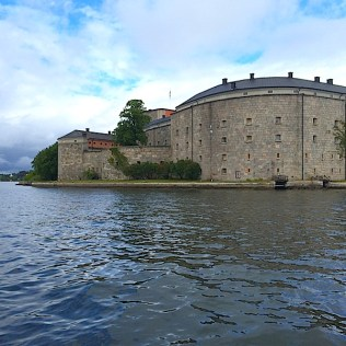 Approaching by launch the Kastellet Bed & Breakfast in Vaxholm, Sweden. By C.S. White