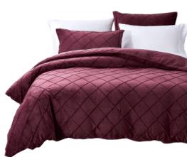 a red velvet duvet set to stay cozy during winter