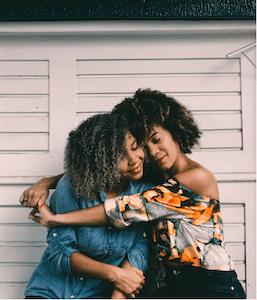 2 ladies hugging in their endometriosis support group