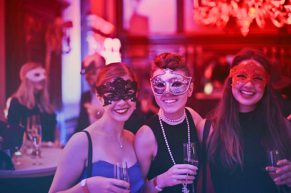 A picture of three girls in party masks. The most important bachelorette party advice is to make sure your party is unique to your bride.