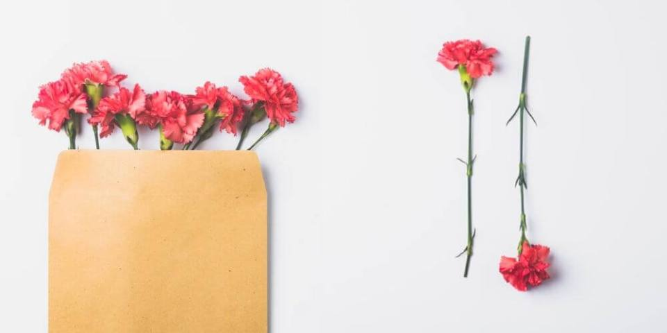 manila envelope with red flowers