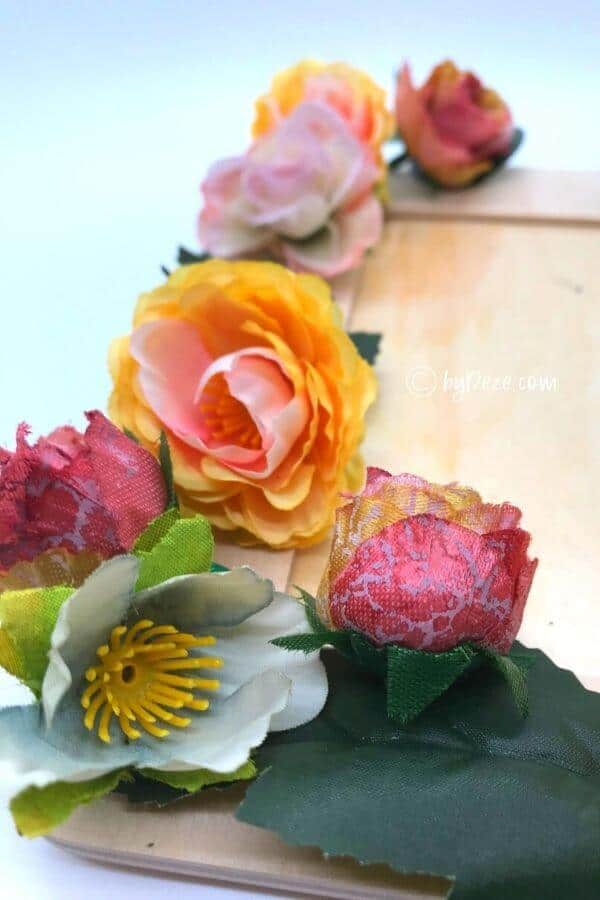 close up of faux flowers for diy flower picture frame