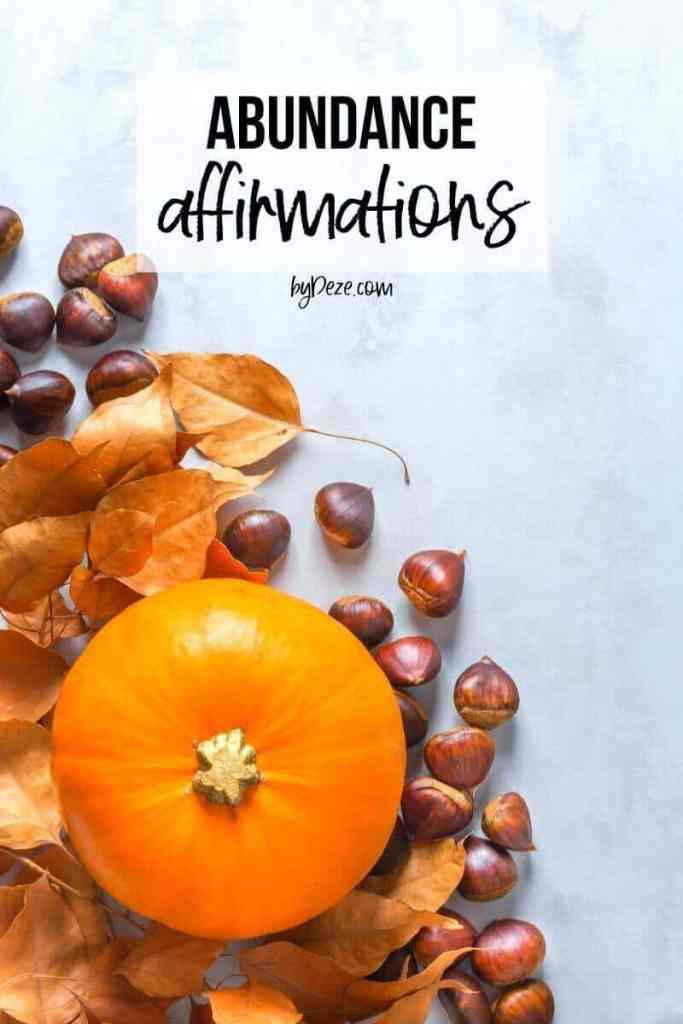 pumpkin and cornucopia with the title abundance affirmations