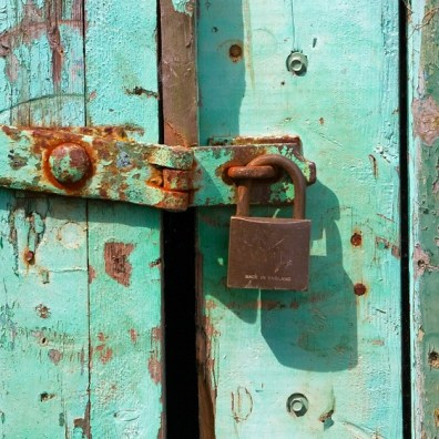 Outdated Padlocked Wood Door