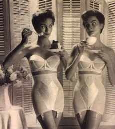 This photo suggests that, with the proper undergarments, a women can eat what she wants and still maintain a perfect hourglass figure.