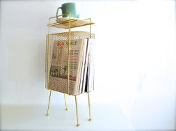 a wire magazine rack looks cool and can be used for props