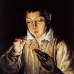 boy coaxing a flame