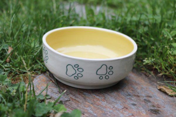 Gamelle jaune pour chat ou chien en céramique coloré avec traces de pattes