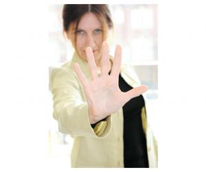 Image of woman motioning to halt