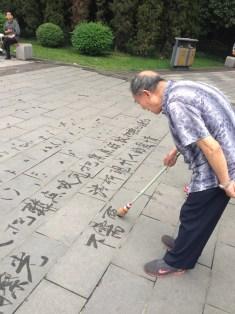 Vanishing calligraphy on tiles