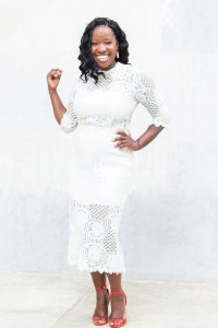 Multicultural wedding photographer Petronella Lugemwa of Petronella Photography dressed in white lace dress