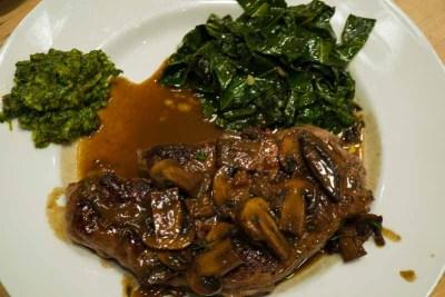 steak served with collard greens
