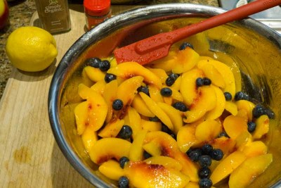 peaches and blueberries in bowl