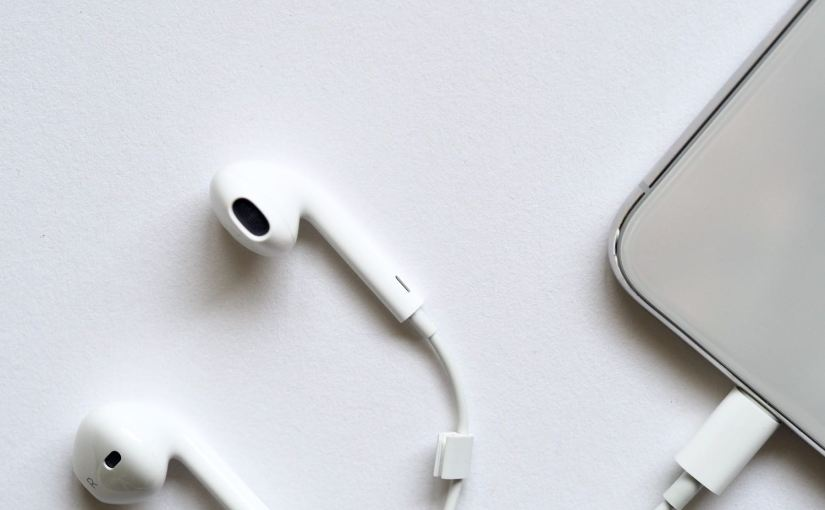 Photograph of earbuds plugged into a smartphone