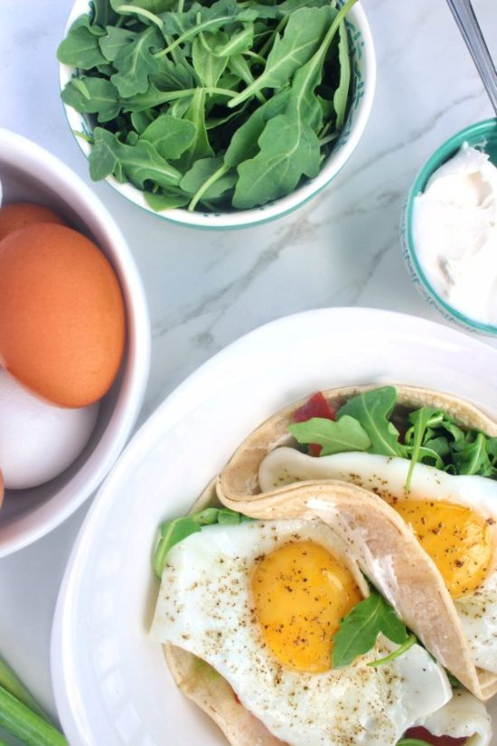 Rise and shine with Smoked Salmon Breakfast Tacos with Fried and Avocado - a restaurant quality brunch dish that comes together in less than 10 minutes for a fraction of the price! This savory breakfast is filled with protein and healthy fats to keep you full for hours. | www.bytesizednutrition.com