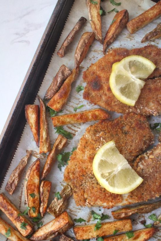 Enjoy fish n' chips from the comfort of your own home - no deep fryer required! Sheet Pan Beer-Battered Baked Fish and Chips is a healthy and easy meal the whole family will love! | www.bytesizednutrition.com