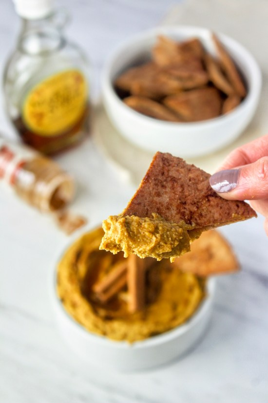 Pumpkin Pie Dessert Hummus is a quick and easy protein-packed dip that tastes like pumpkin pie filling! Serve with homemade cinnamon sugar pita chips for a delicious fall snack or sweet treat! | www.bytesizednutrition.com