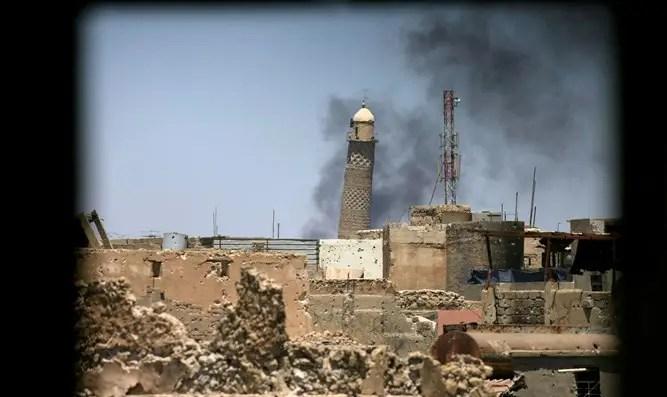 Smoke rises from Grand al-Nuri mosque in Mosul