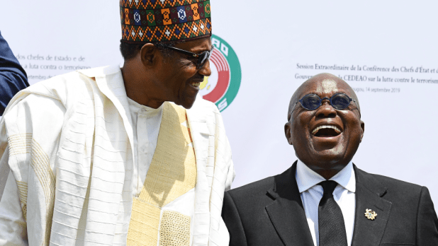 Mohammed Muhari Buhari of Nigeria and Nana Akufo-Addo of Ghana after the opening ceremony of an Ecowas meeting in Burkina Faso 14 September 2019