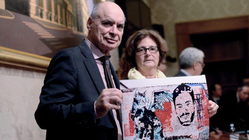 Claudio Regeni (L) and Paola Regeni (R) show a photo depicting their son Giulio Regeni at the Italian Senate on April 3, 2017 in Rome
