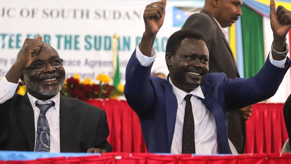 L-R: Gibril Ibrahim Mohammed, leader of Sudan's Justice and Equality Movement (Jem) and Minni Minnawi of Sudan Liberation Movement/Army (SLM/A) gesture after the signing of the peace agreement - 31 August 2020