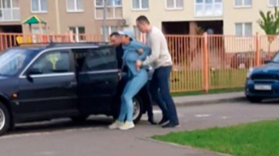Woman bundled into car in Minsk