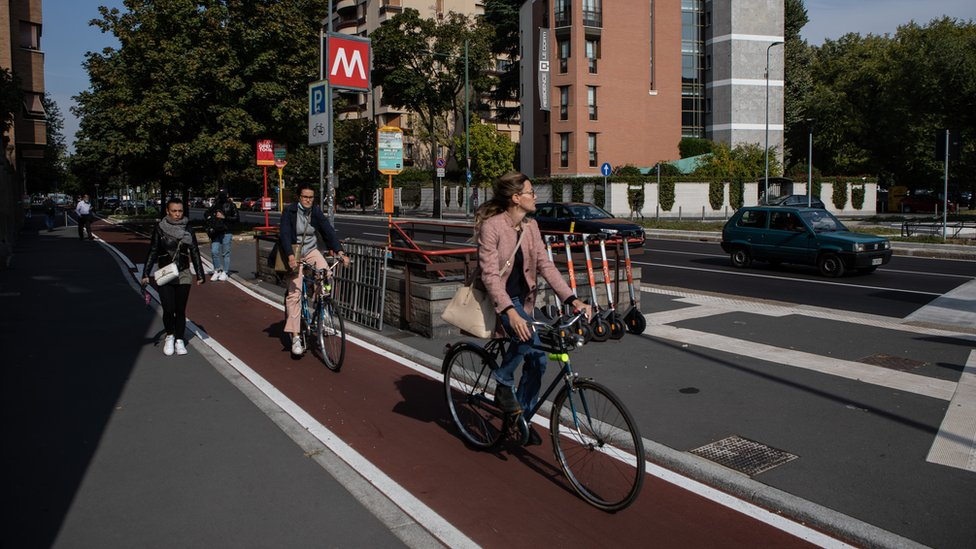 Cyclists ride on a brand new cycle path on Via Monte Rosa on September 30, 2020 in Milan