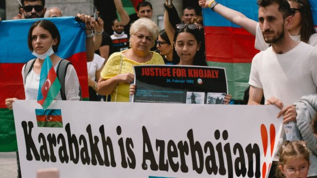 Protesters in Germany holding a sign saying Karabakh is Azerbaijan