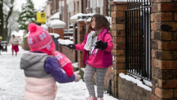 Children play with snowballs in Stoke-on-Trent, Staffordshire.