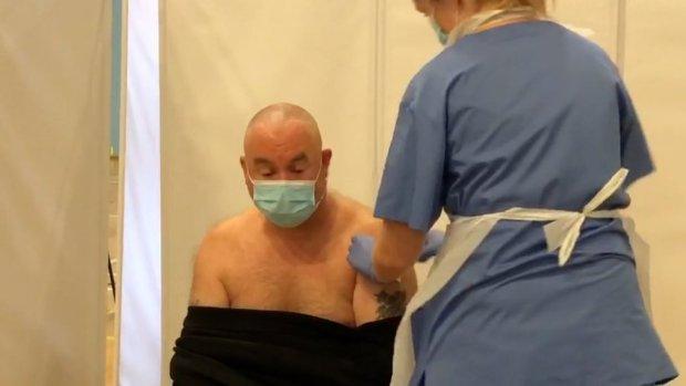 Craig Atkins getting vaccine