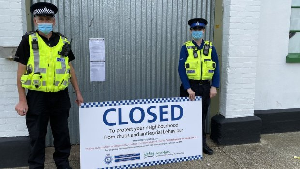 Hertfordshire Police officers outside a closed industrial unit.