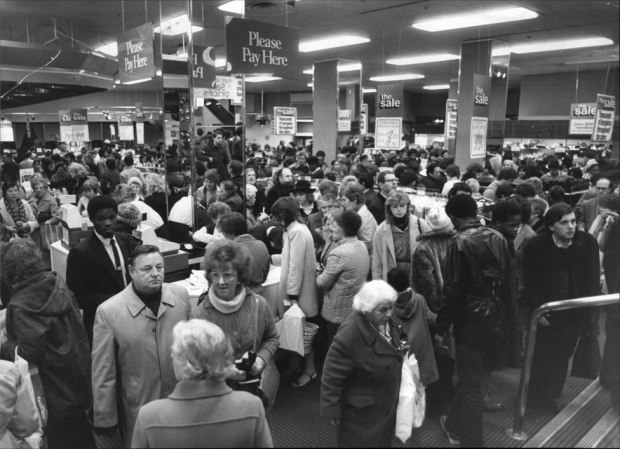 A crowd of shoppers in a Debenhams store