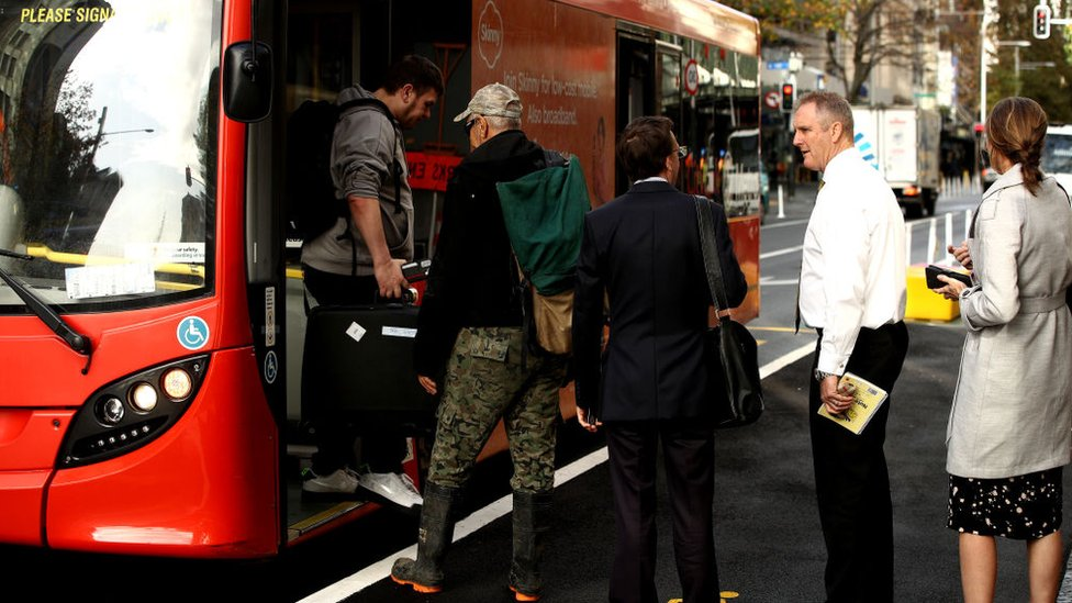 People boarding a bus in Aukland